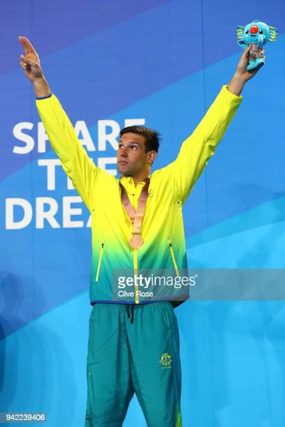 Bronze medalist Daniel Fox of Australia poses during the medal ceremony for the Men's S14 200m Freestyle Final on day one of the Gold Coast 2018...