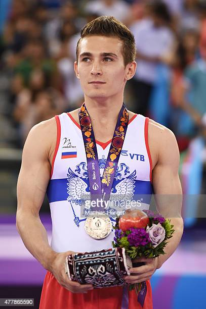 Bronze medalist David Belyavskiy of Russia stands on the podium during the medal ceremony for the Men's Floor Exercise final on day eight of the Baku...