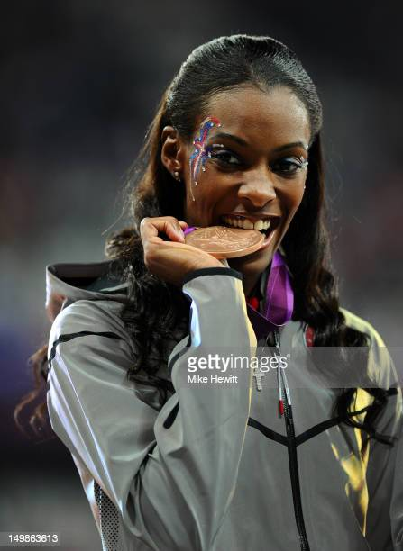 Bronze medalist DeeDee Trotter of the United States poses on the podium during the medal ceremony for the Women's 400m Final on Day 9 of the London...