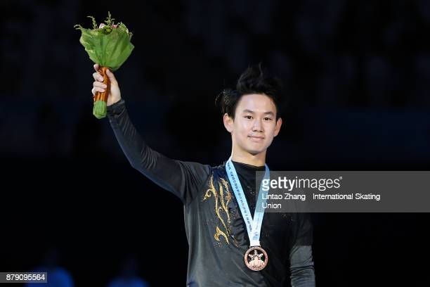 Bronze medalist Denis Ten of Kazakhstan looks on in the victory ceremony for men free skating during the 2017 Shanghai Trophy at the Oriental Sports...