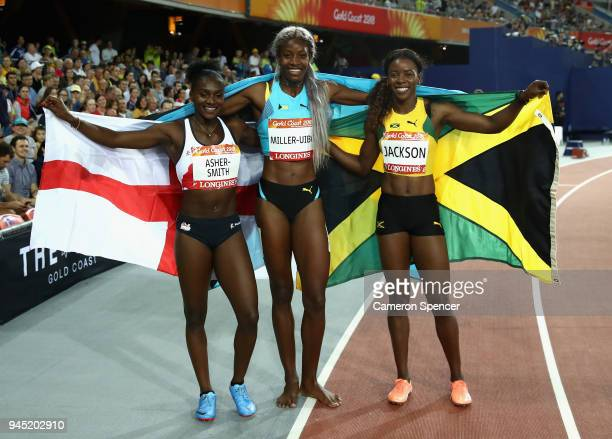 Bronze medalist Dina Asher-Smith, gold medalist Shaunae Miller-Uibo of the Bahamas and silver medalist Shericka Jackson of Jamaica celebrate after...