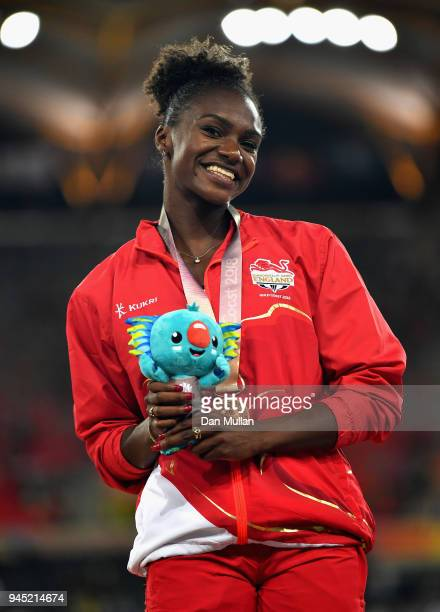 Bronze medalist Dina AsherSmith of England looks on during the medal ceremony for the Women's 200 metresduring athletics on day eight of the Gold...