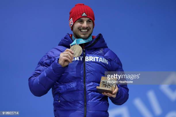 Bronze medalist Dom Parsons of Great Britain celebrates during the Medal Ceremony for Skeleton Men on day seven of the PyeongChang 2018 Winter...