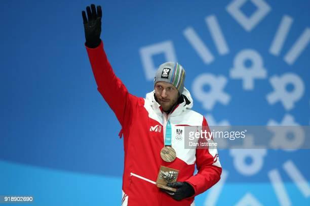 Bronze medalist Dominik Landertinger of Austria celebrates during the Medal Ceremony for Biathlon Men's 20km Individual on day seven of the...