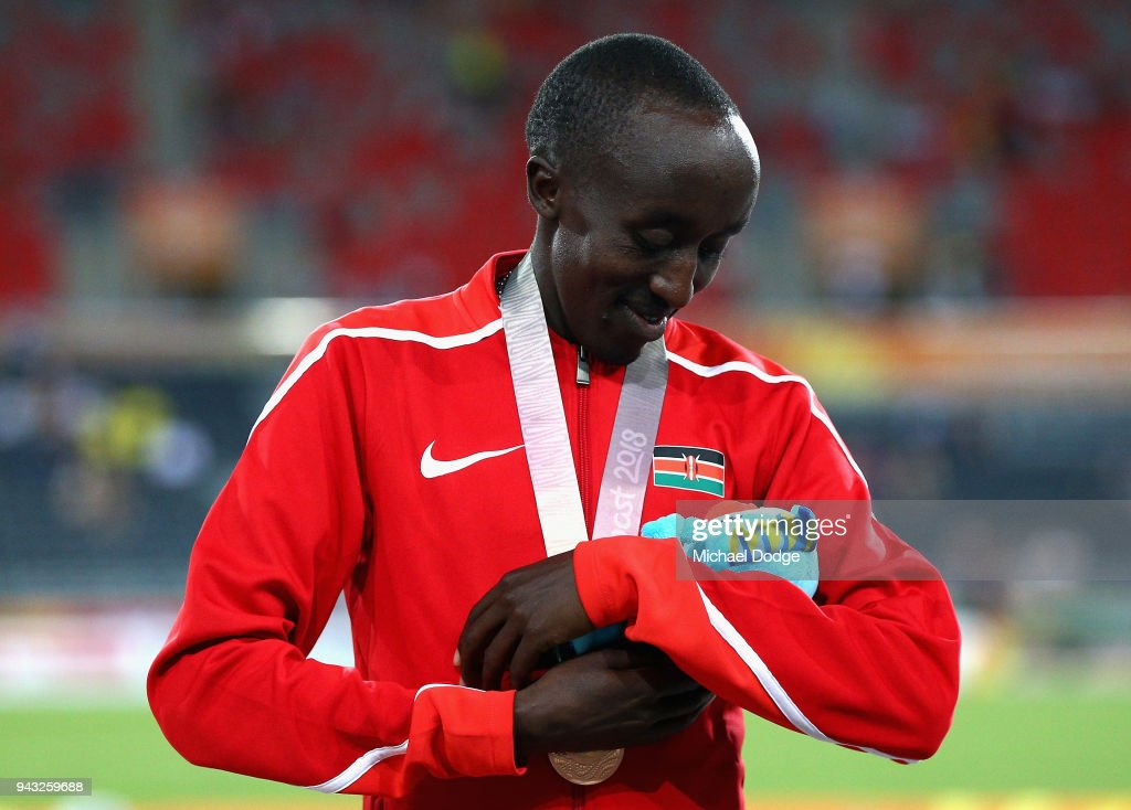 Bronze medalist Edward Pingua Zakayo of Kenya jokes with his mascot during the medal ceremony for the Men's 5000m Final on day four of the Gold Coast 2018 Commonwealth Games at Carrara Stadium on April 8, 2018 on the Gold Coast, Australia.