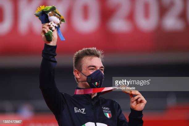 Bronze medalist Elia Viviani of Team Italy, poses on the podium during the medal ceremony after the Men's Omnium final of the track cycling on day...