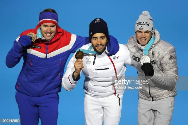 Bronze medalist Emil Hegle Svendsen of Norway, gold medalist Martin Fourcade of France and silver medalist Simon Schempp of Germany celebrate during...