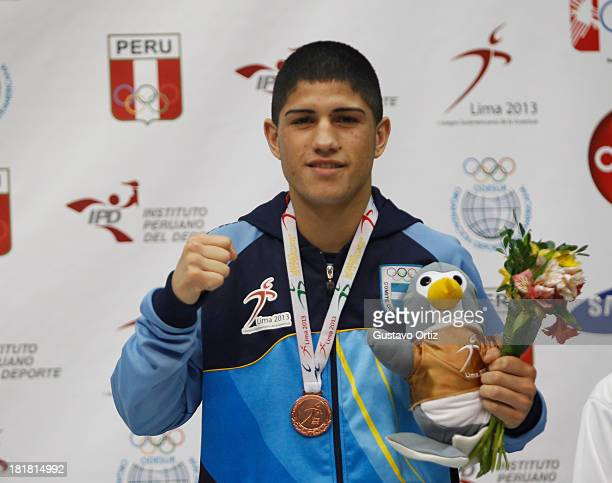 Bronze medalist Emiliano Paz of Argentina in the podium of Boxing 60kg as part of the I ODESUR South American Youth Games at Coliseo Miguel Grau on...