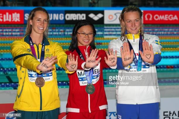 Bronze medalist Emma McKeon of Australia gold medalist Margaret MacNeil of Canada and silver medalist Sarah Sjostrom of Sweden pose during the medal...