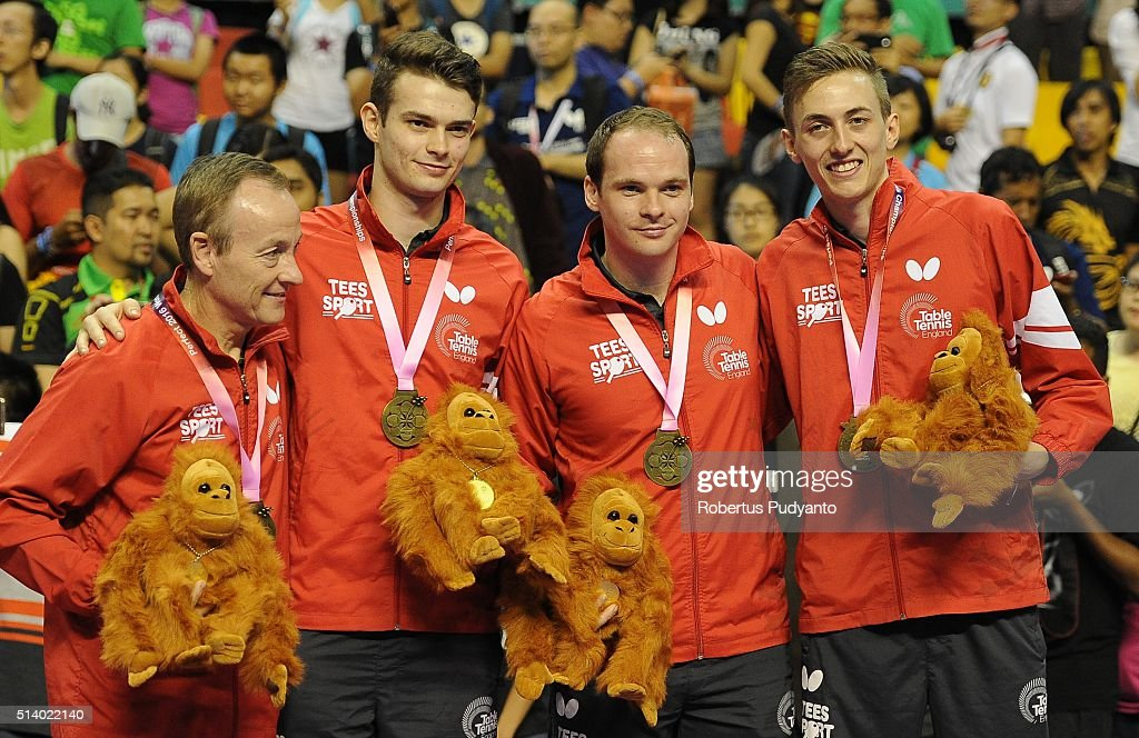 Bronze medalist England team celebrate on the podium during the 2016 World Table Tennis Championship Men's Team Division awarding ceremony at Malawati Stadium on March 6, 2016 in Shah Alam, Malaysia.