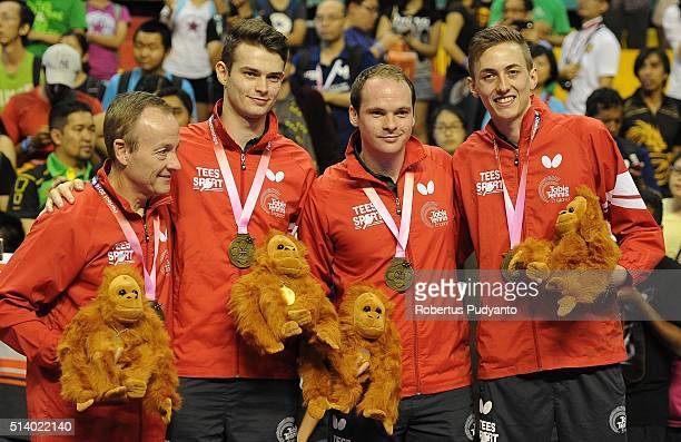 Bronze medalist England team celebrate on the podium during the 2016 World Table Tennis Championship Men's Team Division awarding ceremony at...
