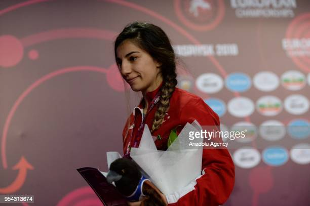 Bronze medalist Evin Demirhan of Turkey on stage after competing in the women's 50 kg category within the 2018 European Wrestling Championships in...