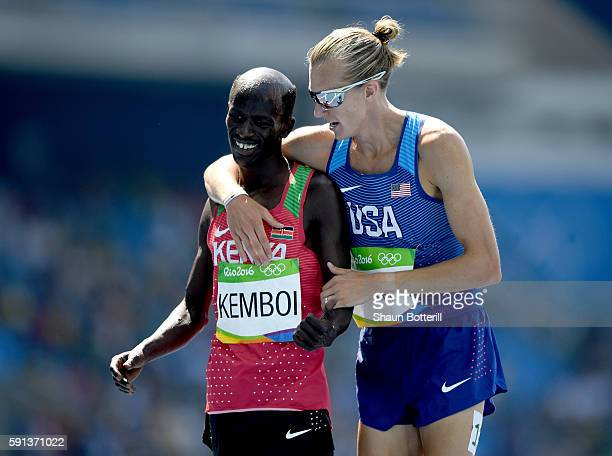 Bronze medalist Ezekiel Kemboi of Kenya and silver medalist Evan Jager of the United States celebrate after the Men's 3000m Steeplechase Final on Day...