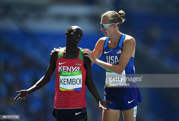 Bronze medalist Ezekiel Kemboi of Kenya and silver medalist Evan Jager of the United States react after the Men's 3000m Steeplechase Final on Day 12...