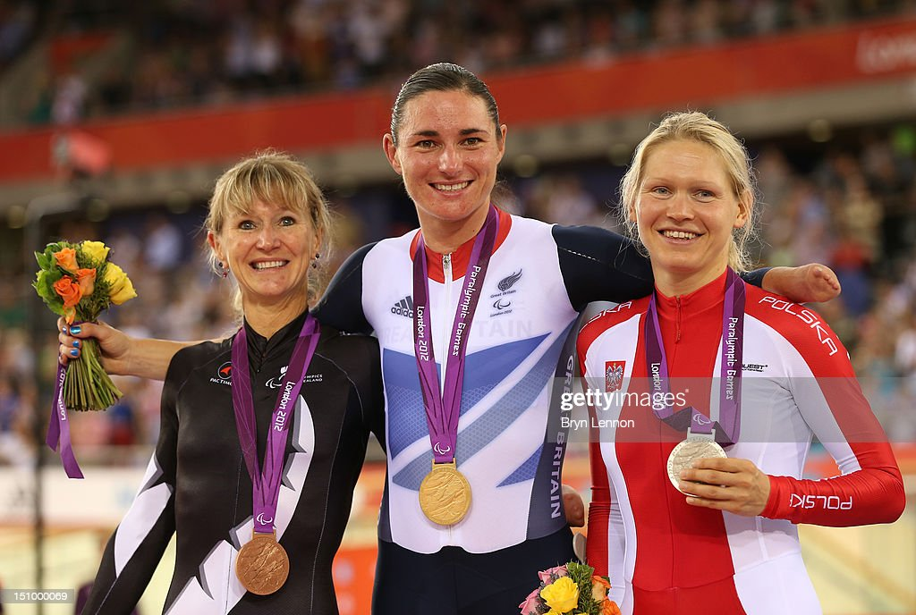Bronze medalist Fiona Southorn of New Zealand, Gold medalist Sarah Storey of Great Britain and silver medalist Anna Harkowska of Poland pose on the podium during the victory ceremony for the Women's Individual C5 Pursuit Cycling on day 1 of the London 2012 Paralympic Games at Velodrome on August 30, 2012 in London, England.