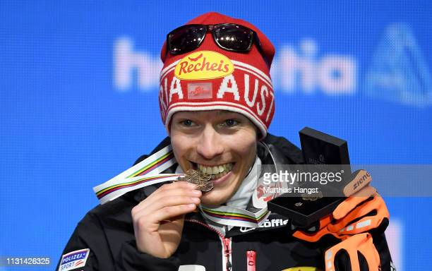 Bronze medalist Franz Josef Rehrl of Austria celebrates with his medal during the medal ceremony for the Nordic Combined Competition of the FIS...