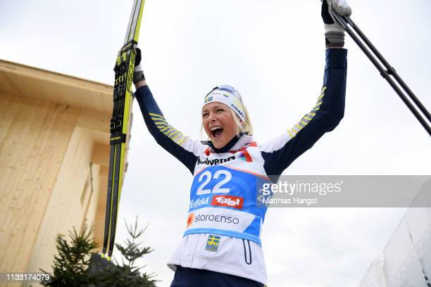 Bronze medalist Frida Karlsson of Sweden celebrates following the Women's Cross Country 30k race during the FIS Nordic World Ski Championships on...