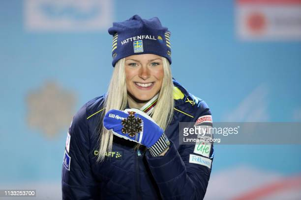 Bronze medalist Frida Karlsson of Sweden celebrates with her medal during the Medal Ceremony for the Women's Cross Country 30k race during FIS Nordic...