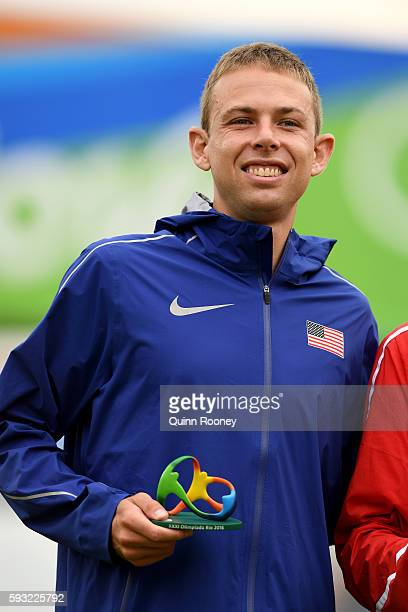 Bronze medalist Galen Rupp of the United States celebrates on the podium during victory ceremony after the Men's Marathon on Day 16 of the Rio 2016...