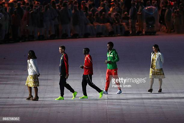 Bronze medalist Galen Rupp of the United States gold medalist Eliud Kipchoge of Kenya and Silver medalist Feyisa Lilesa of Ethiopia leave after the...