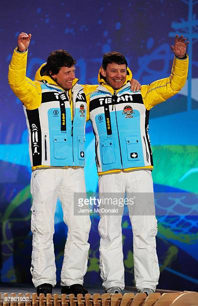 Bronze medalist Gerd Gradwohl of Germany and guide Karl-Heinz Vachenauer celebrate during the medal ceremony for the Men's Visually Impaired Downhill...