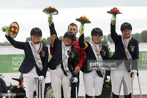 Bronze medalist German team Elke Philipp Hannelore Brenner Carolin Schnarre and Britta Napel celebrate on the podium during the medal ceremony of the...