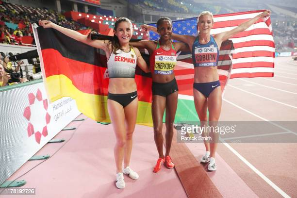 Bronze medalist Gesa Felicitas Krause of Germany gold medalist Beatrice Chepkoech of Kenya and silver medalist Emma Coburn of the United States pose...