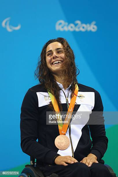 Bronze medalist Giulia Ghiretti of Italy celebrates on the podium at the medal ceremony for the Women's 50m Butterfly S5 on day 3 of the Rio 2016...