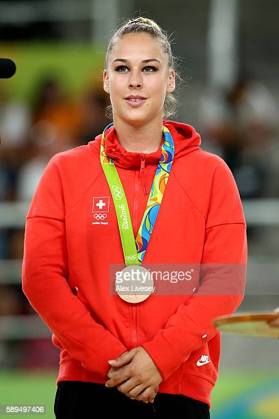 Bronze medalist Giulia Steingruber of Switzerland celebrates on the podium at the medal ceremony for Women's Vault on Day 9 of the Rio 2016 Olympic...