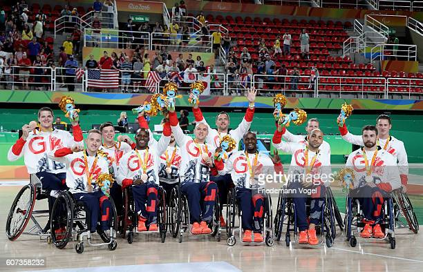 Bronze medalist Great Britain celebrate on the podium at the medal ceremony after the Men's Wheelchair Basketball competition at Olympic Arena on day...