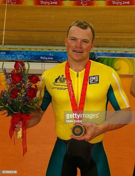 Bronze medalist Greg Ball of Australia poses with his medal after presentation for the men's 1km time trial in the Track Cycling event at Laoshan...