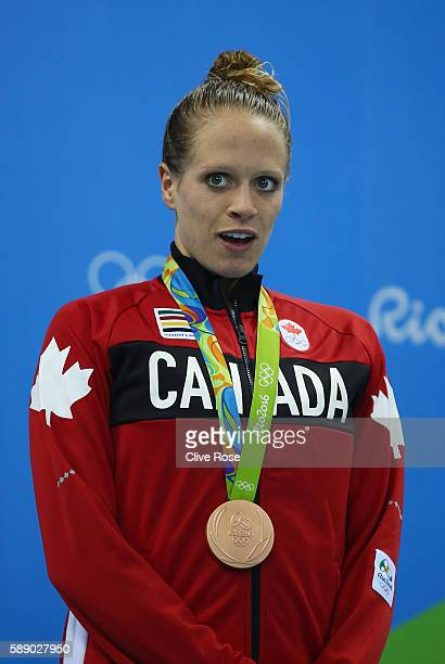 Bronze medalist Hilary Caldwell of Canada celebrates on the podium during the medal ceremony for the Women's 200m Backstroke Final on Day 7 of the...