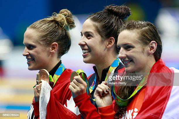 Bronze medalist Hilary Caldwell of Canada gold medalist Madeline Dirado of the United States and Silver medalist Katinka Hosszu of Hungary pose...