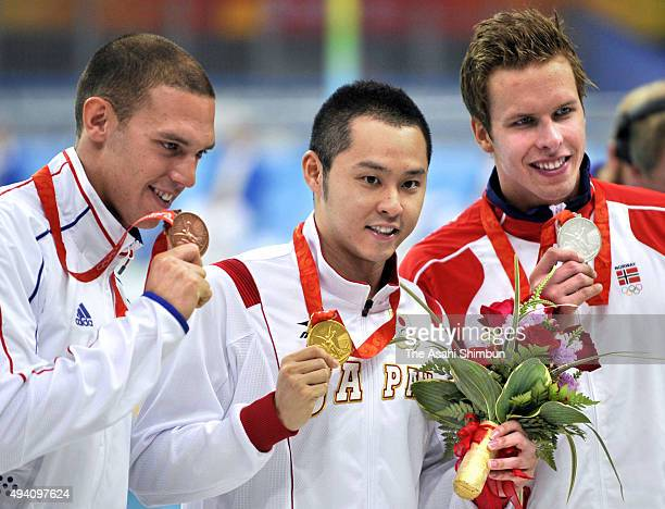 Bronze medalist Hugues Duboscq of France gold medalist Kosuke Kitajima of Japan and Silver medalist Alexander Dale Oen of Norway pose with their...