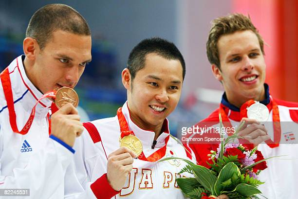 Bronze medalist Hugues Duboscq of France, gold medalist Kosuke Kitajima of Japan and Silver medalist Alexander Dale Oen of Norway pose with their...