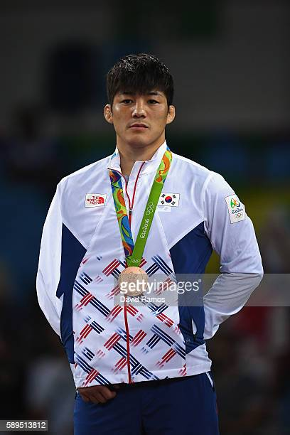 Bronze medalist Hyeonwoo Kim of Korea stands on the podium at the medal ceremony following the Men's GrecoRoman 75 kg competition on Day 9 of the Rio...