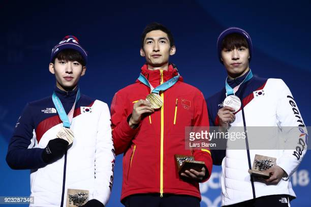 Bronze medalist Hyojun Lim of Korea gold medalist Dajing Wu of China and silver medalist Daeheon Hwang of Korea stand on the podium during the medal...