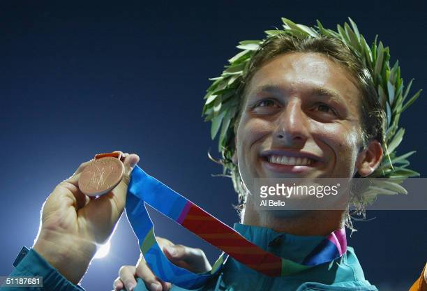 Bronze medalist Ian Thorpe of Australia celebrate on the podium during the men's swimming 100 metre freestyle event on August 18 2004 during the...