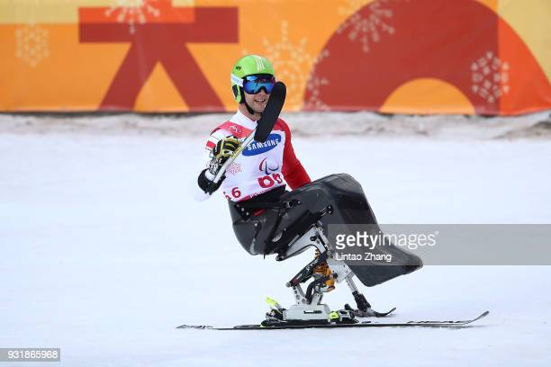 Bronze Medalist Igor Sikorski of Poland celebrates after Men's Giant Slalom Run Sitting at Alpensia Biathlon Centre on day five of the PyeongChang...