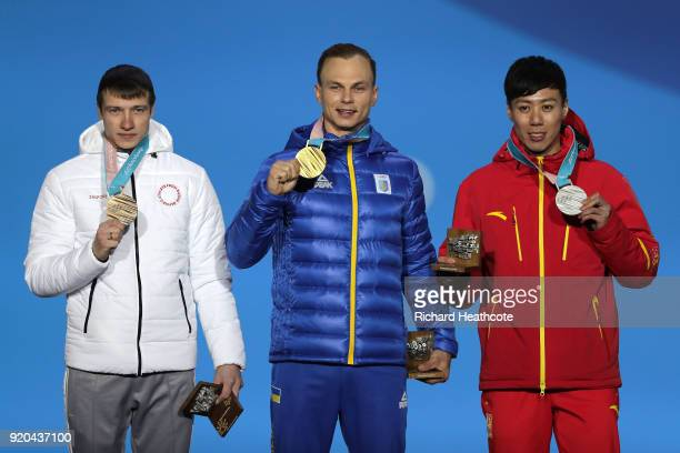 Bronze medalist Ilia Burov of Olympic Athlete from Russia, gold medalist Oleksandr Abramenko of Ukraine and silver medalist Zongyang Jia of China...