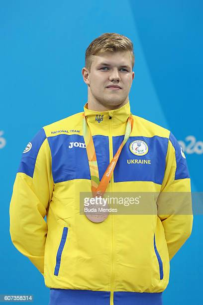 Bronze medalist Illia Yaremenko of Ukraine pose on the podium at the medal ceremony for the Men's 50m Freestyle S12 on day 10 of the Rio 2016...