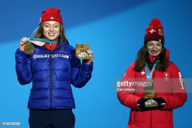 Bronze medalist Isabel Atkin of Great Britain and gold medalist Sarah Hoefflin of Switzerland celebrate during the medal ceremony for the Ladies' Ski...