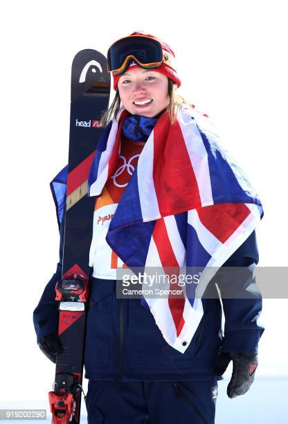 Bronze medalist Isabel Atkin of Great Britain celebrates on the podium following the Freestyle Skiing Ladies' Ski Slopestyle final on day eight of...