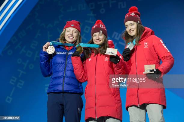 Bronze medalist Isabel Atkin of Great Britain celebrates with Mathilde Gremaud of Switzerland SILVER and team mate Sarah Hofflin GOLD during the...