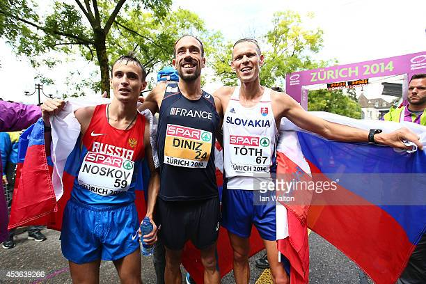 Bronze medalist Ivan Noskov of Russia gold medalist Yohann Diniz of France and silver medalist Matej Toth of Slovakia celebrate after the Men's 50km...