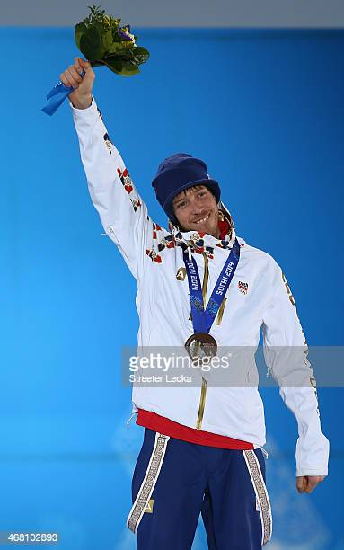 Bronze medalist Jaroslav Soukup of the Czech Republic celebrates during the medal ceremony for the Men's Sprint 10 km on day 2 of the Sochi 2014...