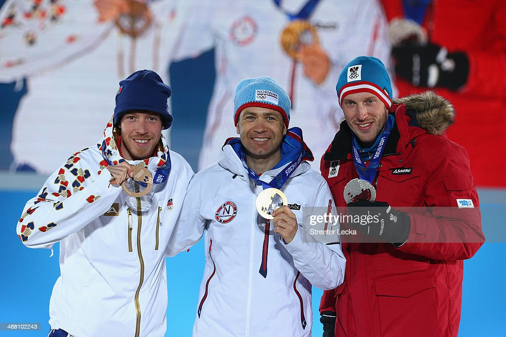 Bronze medalist Jaroslav Soukup of the Czech Republic , gold medalist Ole Einar Bjoerndalen of Norway and Silver medalist Dominik Landertinger of Austria celebrate on the podium during the medal ceremony for the Men's Sprint 10 km on day 2 of the Sochi 2014 Winter Olympics at Medals Plaza on February 9, 2014 in Sochi, .