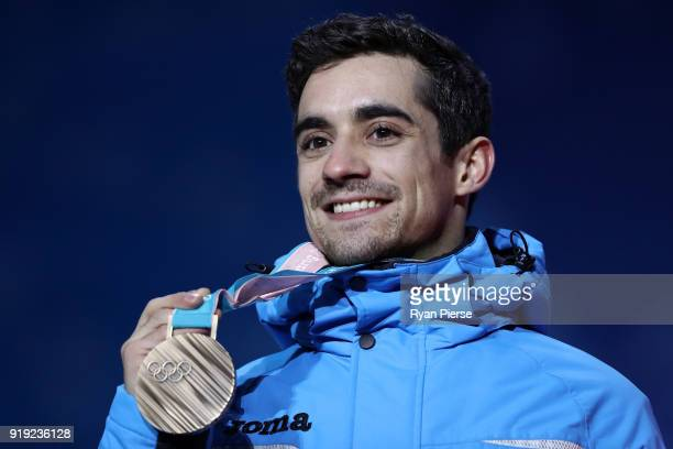 Bronze medalist Javier Fernandez of Spain celebrates during the medal ceremony for the Men's Figure Skating Single Free Skating on day eight of the...