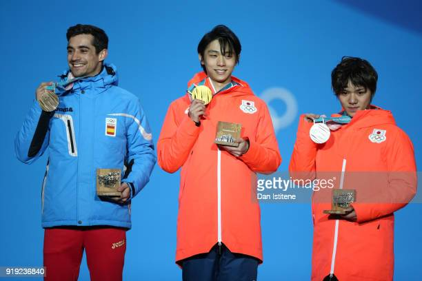 Bronze medalist Javier Fernandez of Spain gold medalist Yuzuru Hanyu of Japan and silver medalist Shoma Uno of Japan celebrate during the medal...