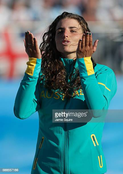Bronze medalist Jessica Fox of Australia blows kisses in the air on the podium during the medal ceremony for the Women's Kayak on Day 6 of the Rio...